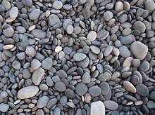 Closeup Of Small Grey Pebbles On A Beach