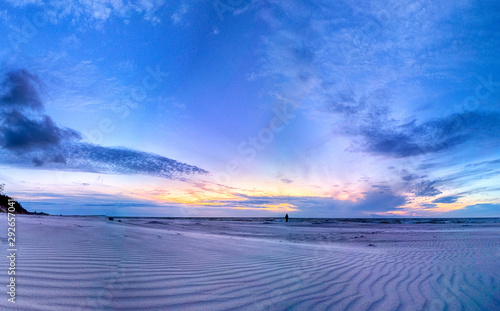 Baltic Sea and beautiful sunset on the beach in Slowinski National Park near Leba, Poland. Wild, untouched nature.
