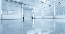 Roller Door Or Roller Shutter Inside Factory, Warehouse Or Industrial Building. Modern Interior Design With Polished Concrete Floor And Empty Space For Product Display, Industry Background. 3d Render.