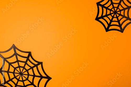 Photo  Orange halloween background with black spiderweb