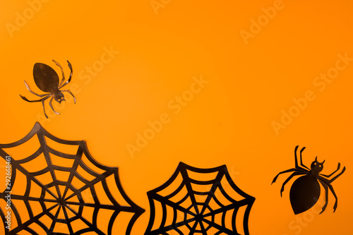 Valokuva  Orange halloween background with black spiderweb
