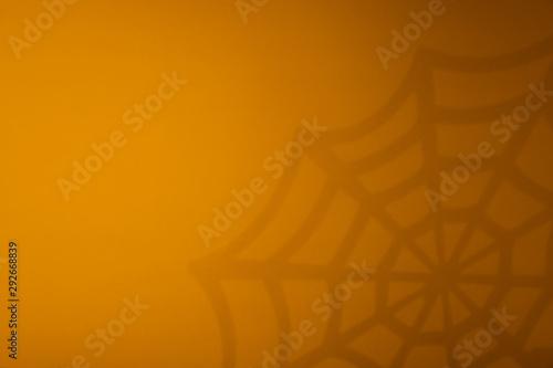 Orange halloween background with black spiderweb Canvas Print