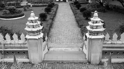 Fotografiet Ho Phra Keo temple Laos sacred holy stairs garden black white