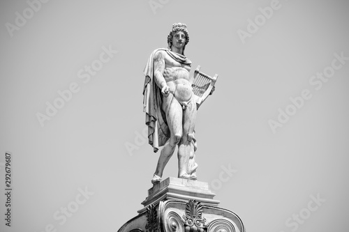 Black and white photo shows the statue of ancient Greek god Apollo Wallpaper Mural