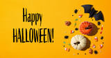 Happy Halloween message with Halloween theme background - flat lay
