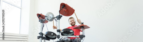 Canvas-taulu Drummer, drum, music and people concept - young man drummer playing in the white
