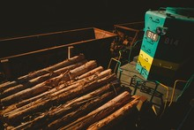 High Angle Shot Of A Train Cart Carrying Piles Of Wood