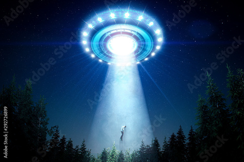 Fotografiet Abducted man by a flying saucer with a bright light ray in the forest - 3D rende