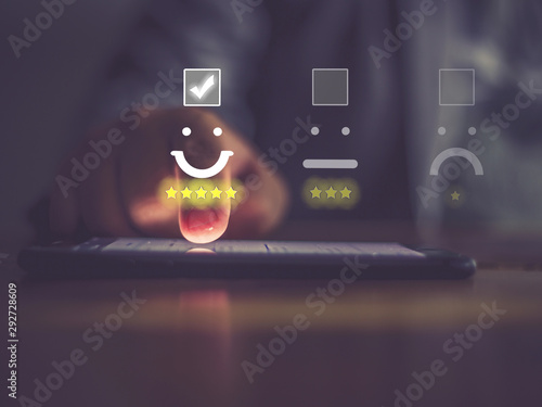 Businessman pressing face emoticon on virtual touch screen at smartphone Canvas Print
