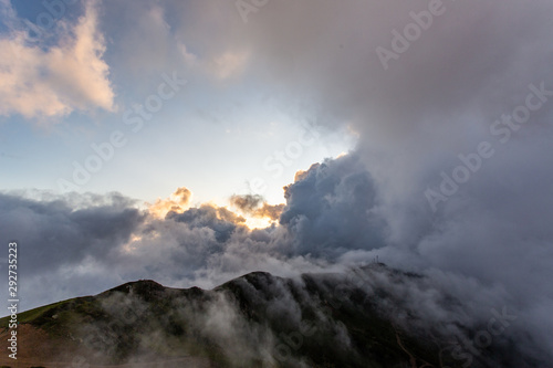 Door stickers Gray Background photo of low clouds in a mountain valley