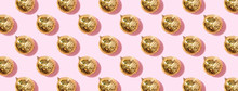 Christmas Gold Baubles Organized On Pink Background. Top View. Flat Lay. Creative New Year Pattern. Party Time Concept. Banner