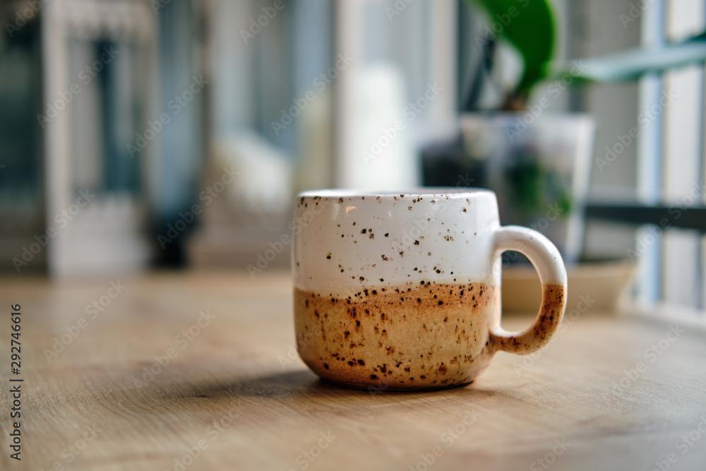 Fototapeta Scandinavian style ceramic cup on wooden table