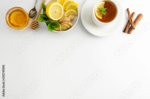 Keuken foto achterwand Thee Fresh tea with lemon and honey on a white background. Hot tea cup isolated, top view flat lay. Flat lay. Autumn, fall or winter drink. Copy space.