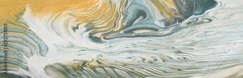 art photography of abstract marbleized effect background. gray, pewter blue, white and gold creative colors. Beautiful paint.