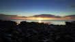 Cargo ship on distant Ocean horizon at dawn stock footage