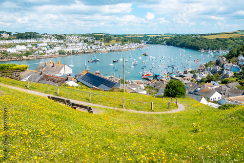 Foto auf Leinwand Gelb Beautiful Cornish harbour towns of Fowey and Polruan, with boats moored in Fowey Estuary, South Cornwall, UK