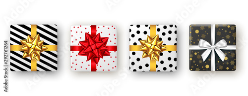 Photo Gift box with red, golden ribbon and bow, top view.