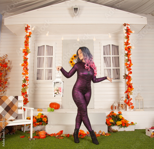 pretty halloween woman in tight tiger jumpsuit ready to celebrate and waiting fo Fototapete