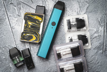 Vape Pod System Or Pod Mod With Changeable Cartridges Close Up - Newest Generation Of Vaping Products - Small Size Devices For Inhaling Higher Nicotine Strengths