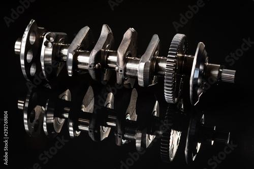 Obraz na plátně  high performance racing motorcycle crankshaft on a reflective black background