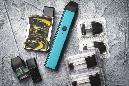 Vape pod system or pod mod with changeable cartridges close up - newest generati Wallpaper Mural