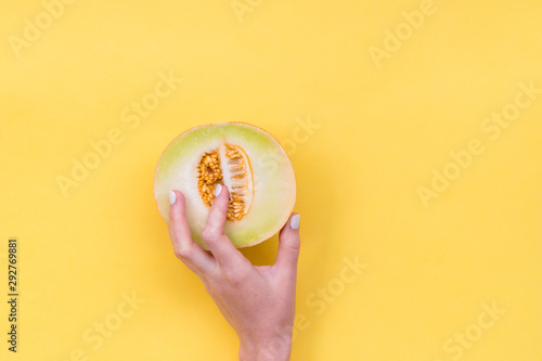 Hand in the melon cut. Melon seeds in a cut. Easy eroticism. Sex concept. - 292769881