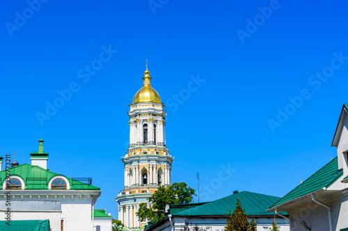 Staande foto Kiev Bell tower of the Kiev Pechersk Lavra against blue sky