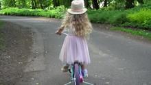 Camera Follows Little Girl Rid...