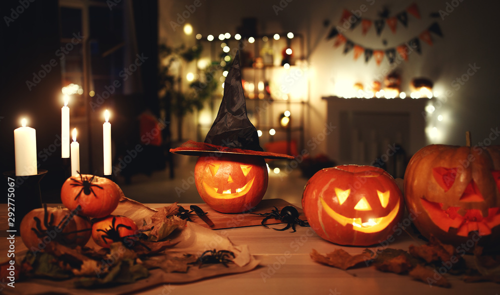 Fototapeta Dark interior of house decorated for Halloween pumpkins, webs and spiders