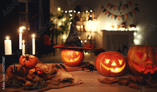 Dark interior of house decorated for Halloween pumpkins, webs and spiders - 292775067