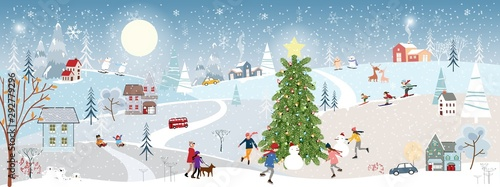 Foto op Canvas Lichtblauw Wonderland Christmas landscape in the town with fairy tale house,polar bear playing ice skates in the park, Winter landscape at night in the city with people having fun celebration on New Year's eve