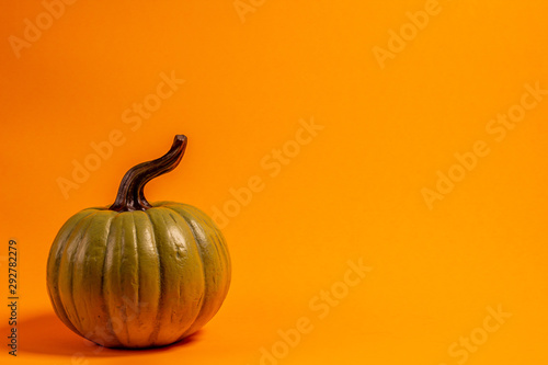 green decorative thanksgiving holiday theme front view on an orange background with room for text
