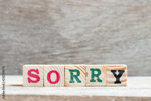 Letter block in word sorry on wood background Wallpaper Mural