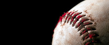 Close Up Of Old Worn Baseball Showing Dirty Red Stitches. Blank Space For Text.