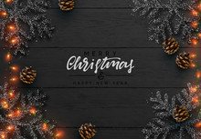 Christmas Background. Wood Plank Texture, Black Snowflakes Are Strewn With Sparkles, Realistic Pine Cones, Decorative Bauble, Gift Boxes, Xmas Bright Light Gold Garland. Merry Christmas Happy New Year