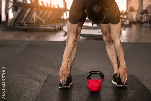 Young athletes man  stretching at the gym. Canvas Print