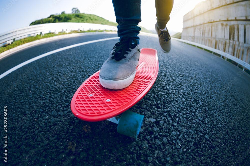 Fototapeta Skateboarder skateboarding on highway road