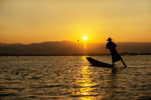The Silhouette Of A Fisherman ...
