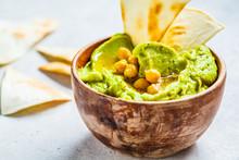 Avocado Hummus In Wooden Bowl. Healthy Vegan Food Concept.