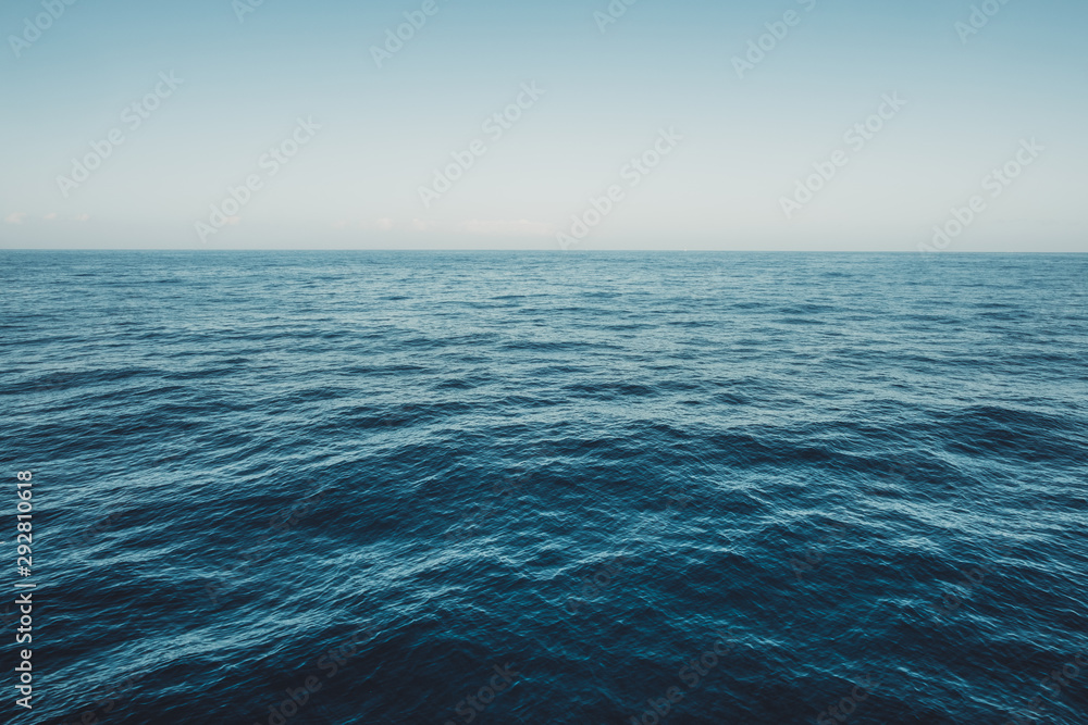 Fotografía  Calm sea surface with waves at sunny day - ocean background
