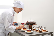 Female Pastry Chef Decorating ...