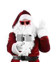Authentic Santa Claus Taking Selfie On White Background