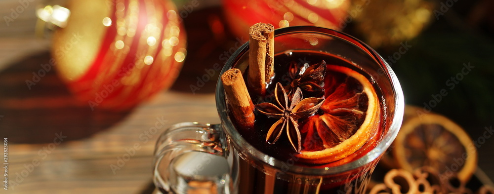 Fototapety, obrazy: Christmas mulled vine with spices sinnamon stiks, anice stars, orange and New Year decorations on a wooden rustik table. Banner. Selective focus. Traditional hot drink at Xmas holiday