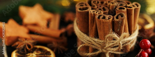 Obraz Sinnamon sticks, anice stars and Christmas, New Year decoration on wooden vintage background selective focus. Banner. Copy space - fototapety do salonu