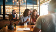 canvas print picture - Diverse young friends laughing over drinks together in a bar