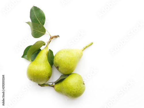 Fényképezés Green pears with leaves isolated on white background, top view