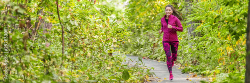 Happy healthy lifestyle active Asian girl jogging outdoors in green woods summer exercise banner panorama.