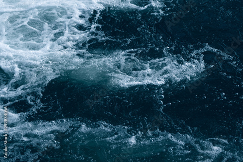 Spoed Fotobehang Onweer Blue and turquoise water with irregular wave structure