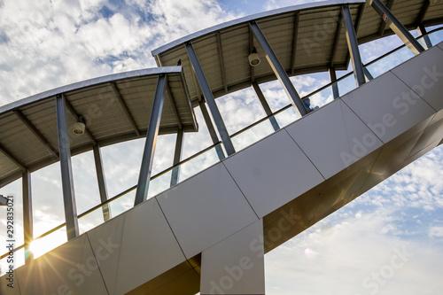 Türaufkleber Darknightsky Outdoor escalator on blue sky and white cloud