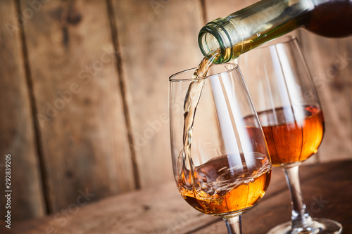 Fotografie, Obraz Aged golden fortified sherry being poured